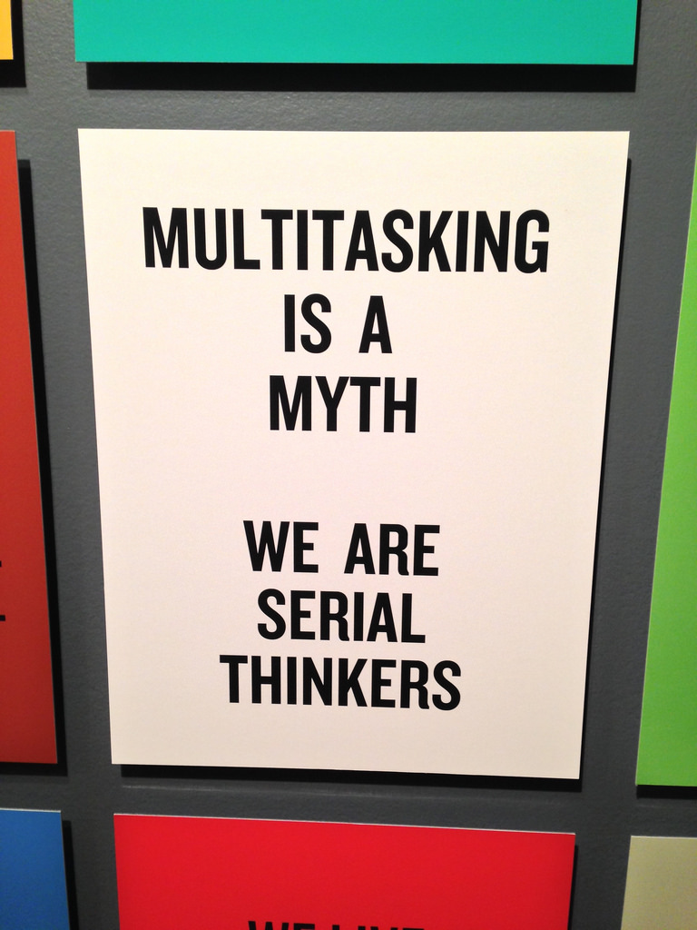 "A sign that reads ""Multitasking is a myth. We are serial thinkers."""