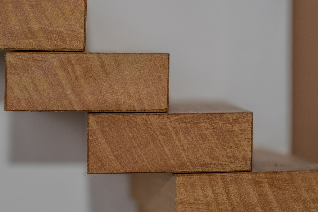 A stacked set of wooden construction blocks