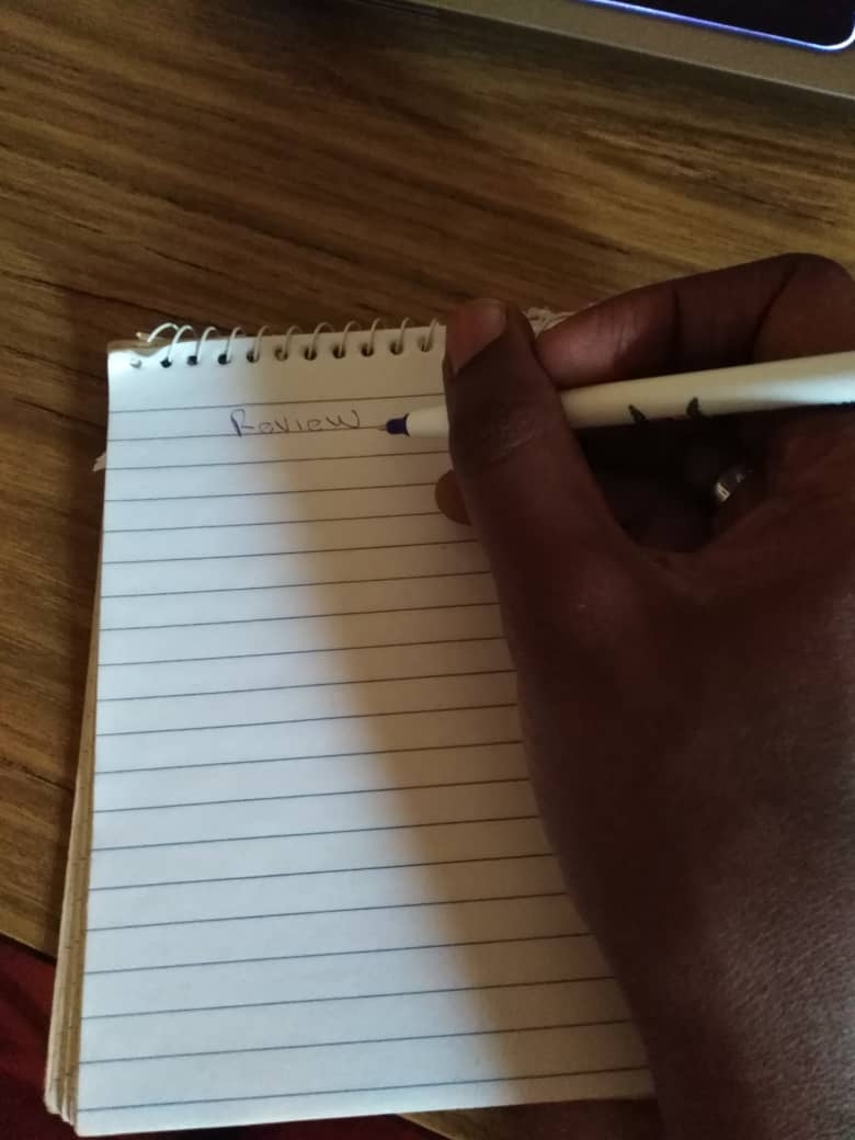 """A spiral notebook. A page is open with the words """"Review"""" written on top"""