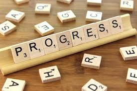 "A scrabble board showing the word ""Progress"""