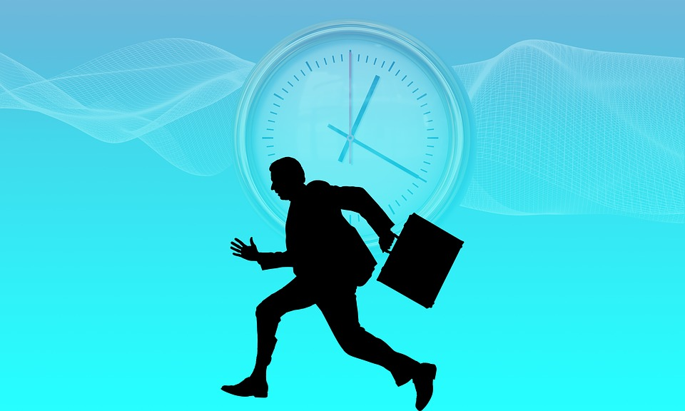 A businessman running with a briefcase. There is a clock in the background.