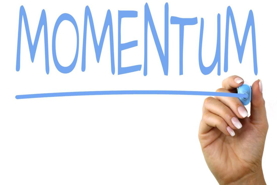 """The Word """"Momentum"""" spelt in blue ink"""