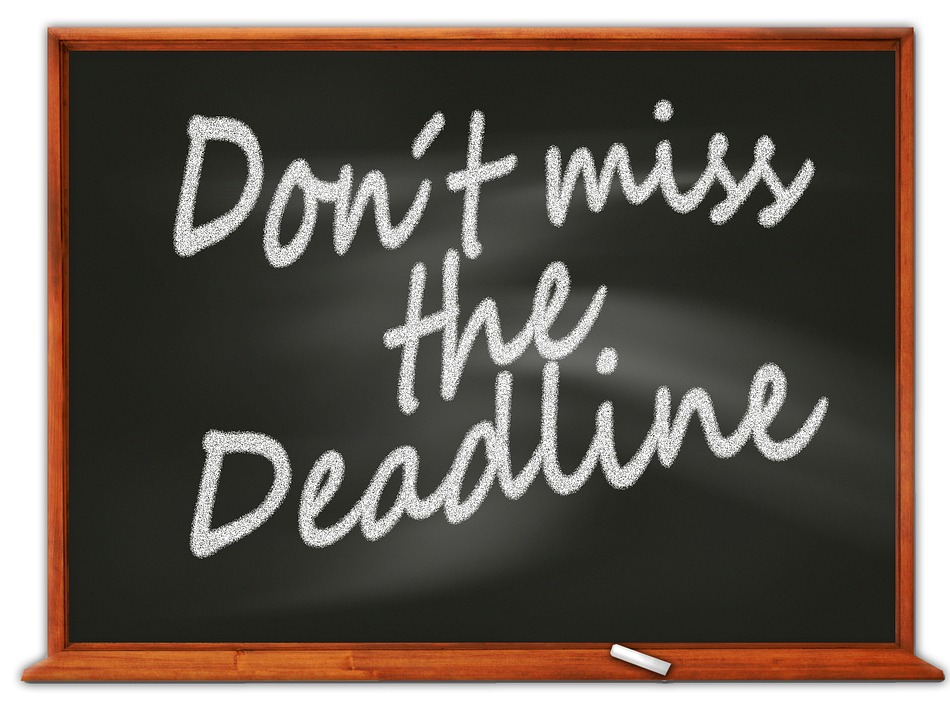 "A blackboard. The words ""Don't miss the deadline"" are written on it in white chalk"