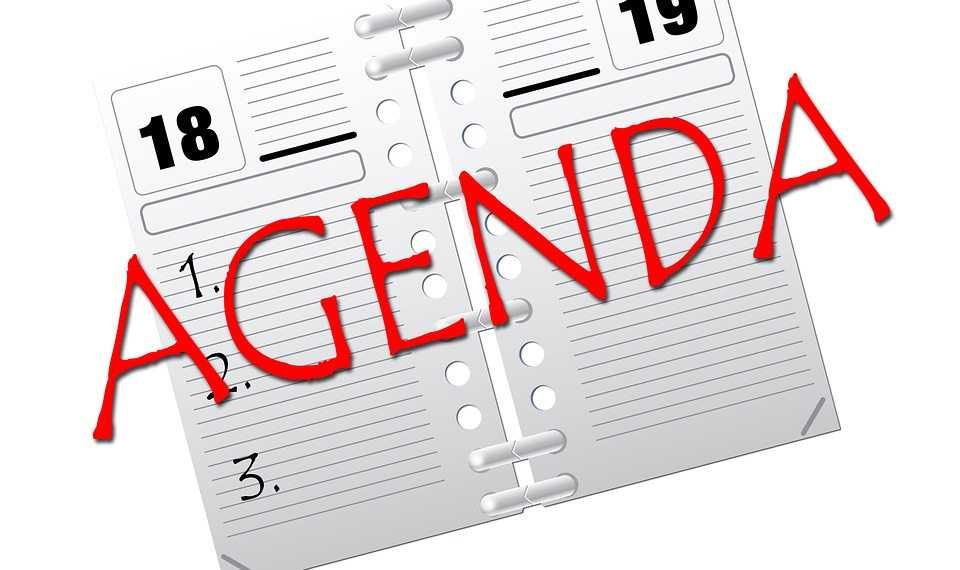 """A calendar with the word """"Agenda"""" stamped in red across it"""