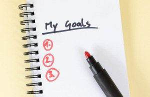 "An open notebook. ""My goals"" is written and underlined"
