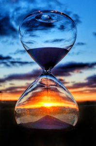 Hourglass against a backdrop of dawn
