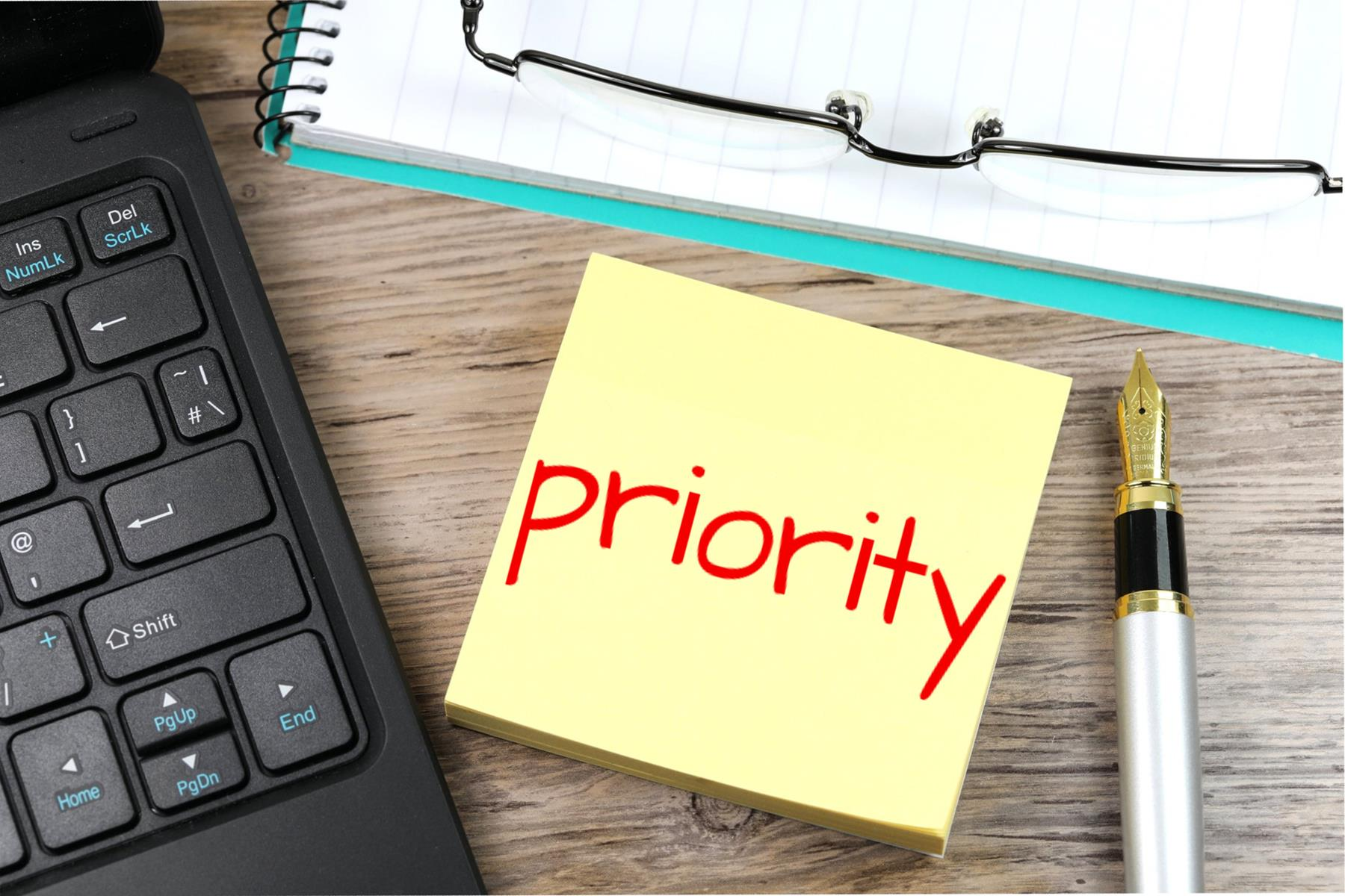 "A sticky note with the word ""priority"" written on it"