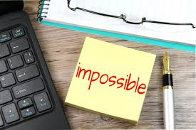 """Sticky note with the word """"impossible"""" written on it"""